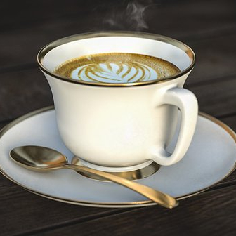 coffee cup with spoon on saucer