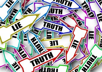 signs - lies & truth mixed in a pile